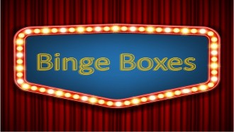 Binge boxes text on a marquee on red curtains