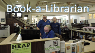 Book a librarian on a picture of the library's reference desk